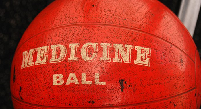 dirty used orange medicine ball in a gym