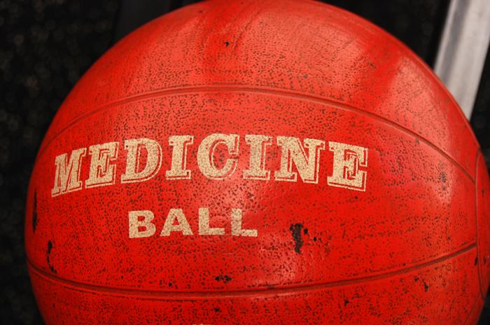 dirty used orange medicine ball in a gym