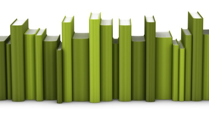 Green books stacked in a horizontal line