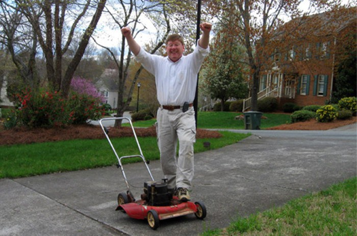 Man cheering because his Toro Mower Still Going Strong...After 40 Years