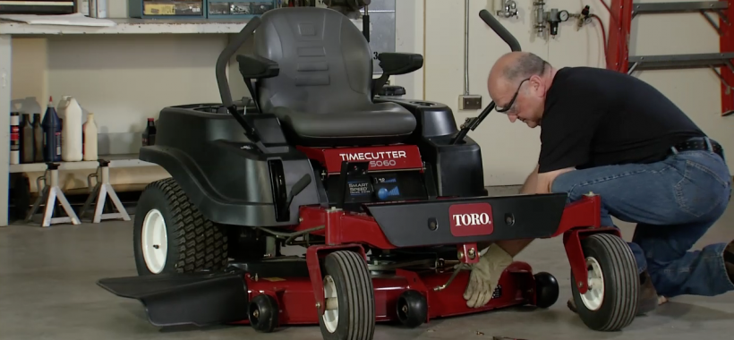 Man removing a Mower Deck - Toro TimeCutter