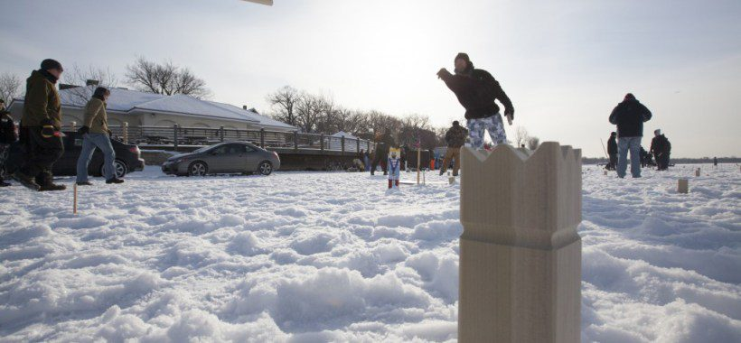 People playing kubb in the winter