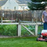 Woman using Toro push lawn mower to maintain grass in extreme heat