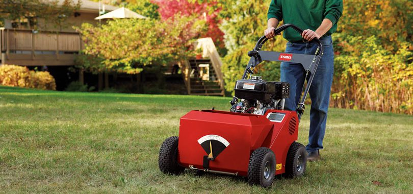 Man pushing Toro Turf Seeder in Backyard